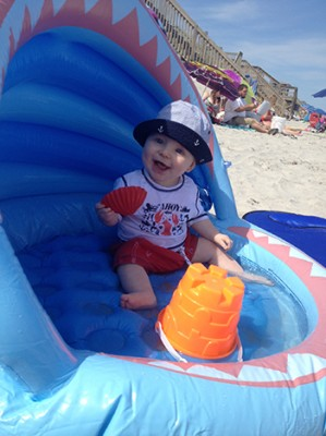 Colin McLean, 9 months old, son of Jeff McLean (graduate student in the math department/School of Education) and Lindsey McLean (staff member in the School of Architecture) enjoys the beach in Surf City, N.C.