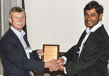Beminiwattha receiving the asdfasdf Award.
