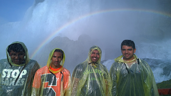 Venkata Karthikeya Jangal, a graduate student in the College of Engineering and Computer Science, and friends encounter a rainbow at Niagara Falls.