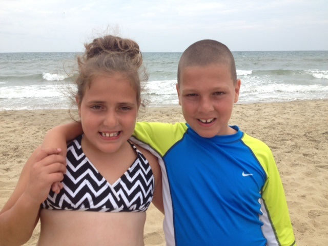 Marissa and Dominick Beitz, 8-year-old twins of Bird Library staff member Susan Beitz, take in the waves at Sandbridge Beach, Va.