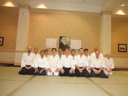 Karen Hall, an academic advisor in the Renée Crown University Honors Program, and her family attended the United States Aikido Federation Summer Camp in Galloway, N.J. Hall, second from left in back row, is pictured here with others from Aikido of CNY.