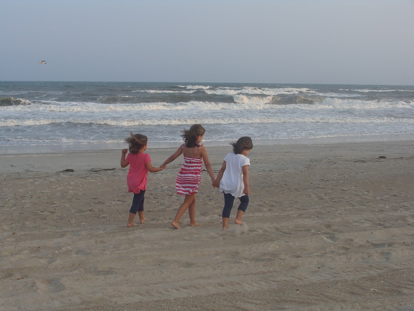 Enjoying a walk on the beach in Emerald Isle, N.C., are Ashley, Emily and Sydney, daughters of Eric Nestor, associate director in the Office of Student Rights and Responsibilities.