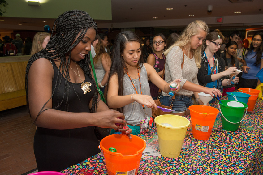 New students try their hand at sand art during Orange After Dark.
