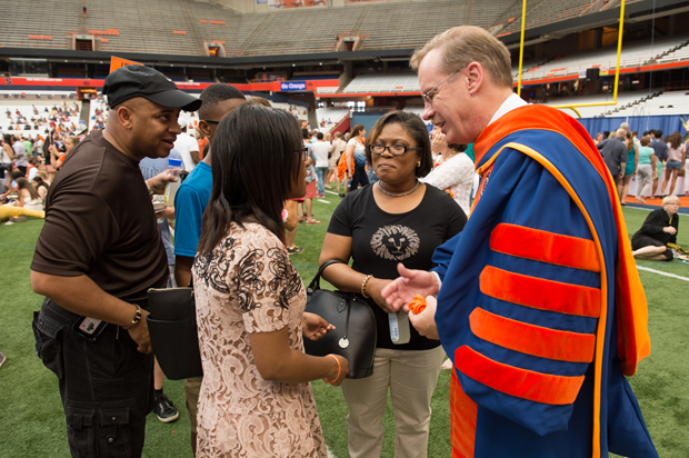 Chancellor Kent Syverud greets parents and families on the Carrier Dome turf, following Friday's Convocation for New Students at Syracuse University and the SUNY College of Environmental Science and Forestry.