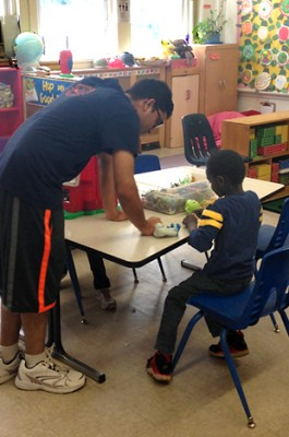 Dhimal works one-on-one with a preschooler.