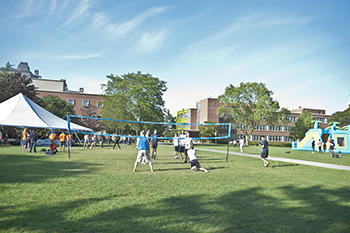 Participants play volleybal at last year's BE-BQ on the Quad.