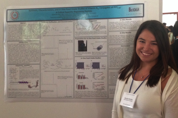 Beckman Scholar Rachael Burke '15 details her research during a poster session.