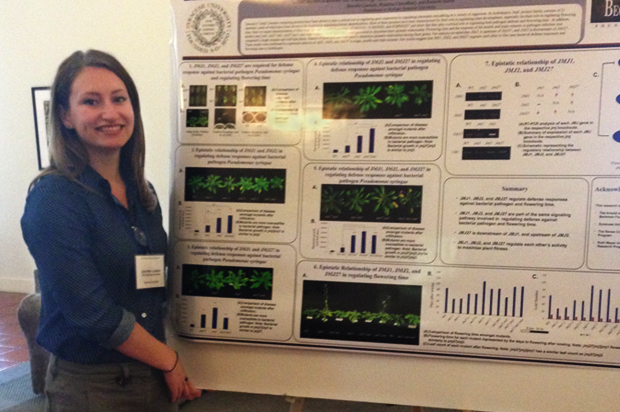 In a poster session, Beckman Scholar Jennifer Lawson '14 explains her research.