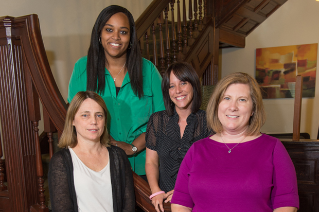 Four members of the Sexual and Relationship Violence Response Team, from left: Susan Pasco, associate director of the Syracuse University Counseling Center, and staff therapists Tekhara Watson, Carrie Brown and Megan Dietz. Not pictured, Cory Wallack, Counseling Center director.