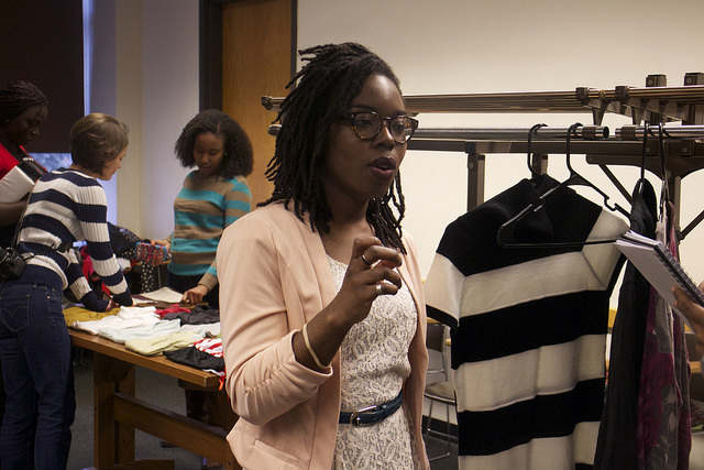 Timi Komonibo G'15 kicks off the first Style Lottery event last spring. Participants bring gently used clothing to swap with others. Photo by Melissa Martinez '16