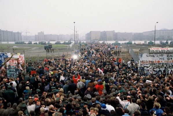 Thousands of East Germans stream through the Berlin Wall a few days after it's opening on November 9th, 1989 when the East German Government announced it would start granting exit visas to anyone who wanted to go to the West. The announcement was misinterpreted as meaning the border was completely open. East German border guards were unable to stop the rush of people which led to the complete opening of the border within days.  (Corbis Images)