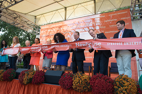 Dignitaries including Oprah Winfrey, center, Chancellor Kent Syverud, second from right, cut the ribbon to open the Newhouse Studio and Innovation Center.