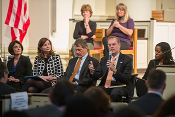 Chancellor Kent Syverud addresses a question during Monday's Fast Forward Syracuse Town Hall in Hendricks Chapel. From left are Kelly Chandler-Olcott, professor and chair of reading and language arts, School of Education; Cathryn Newton, dean emerita and professor of interdisciplinary sciences, College of Arts and Sciences; Jeff Kaplan, senior advisor to the Chancellor and President; Chancellor Syverud; and LaVonda Reed, professor of law, College of Law.