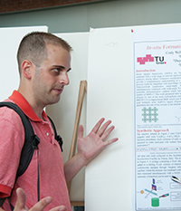 Cody Webb talks about his research project at the poster session.