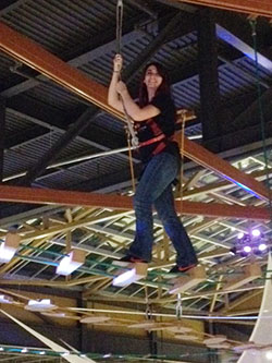 A student negotiates the ropes course at Destiny USA's WonderWorks.