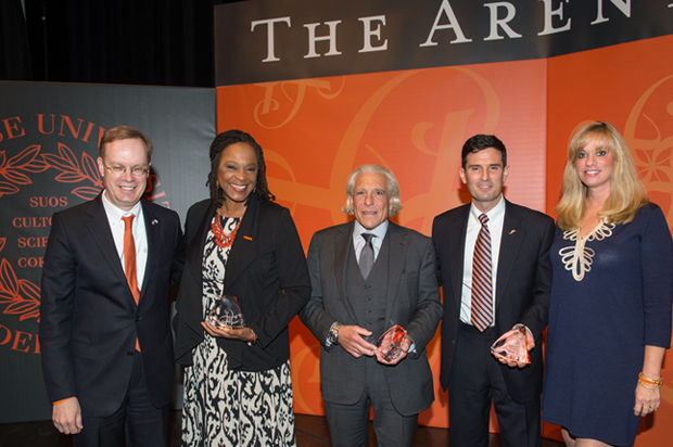 The 2014 Arents Award Luncheon celebrates all alumni and honors recipients of the George Arents Award, Syracuse University's highest alumni award, a highlight of reunion and homecoming weekend. Recipients Angela Y. Robinson '78; Donald Schupak '64, L'66; and Richard M. Jones '92, G'95, L'95; join Chancellor Kent Syverud, left, and Alumni Association President Laurie Taishoff '84, right, on stage.