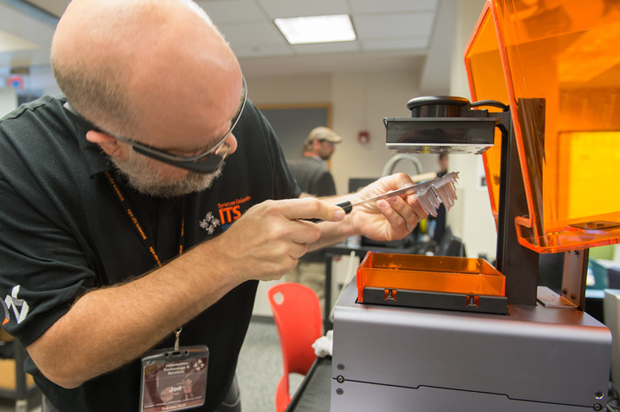 The Raymond von Dran Innovation and Disruptive Entrepreneurship Accelerator (RvD IDEA), named for the former dean of the iSchool, helps students explore entrepreneurship. Orange Central 2014 included an IDEA Juicer event with students competing for startup funding. Here, Google Glass documents the new MakerSpace, cutting edge technology colored Orange!