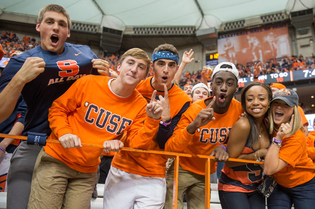 With their Orange spirit strongly evident, students cheer during the 2014 football game against Florida State University.