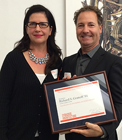 Richard Granoff receives the alumni award from Associate Dean Julia Czerniak.