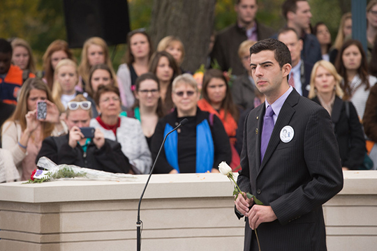 Remembrance Scholar William Fletcher speaks about Syracuse University student Stephen Boland during the Rose-Laying Ceremony in 2013.