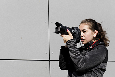 A Newhouse student shoots photos during last year's Fall Workshop.