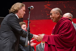 Gregg Lambert greets the Dalai Lama during the latter's visit to the Syracuse University campus in the fall of 2012.