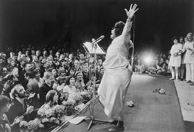 The purview of public address has expanded in recent years to include diverse modes of address. Here, an audience is spellbound by Mahalia Jackson's performance during the Civil Rights era.