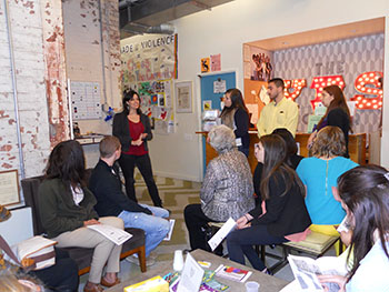 Social work students meet with a program director at The Center, a human service agency, during the April 2014 Mirken Roots of American Social Work trip to New York City.