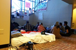 Students set up on the ground floor of Crouse-Hinds Hall