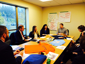 Chancellor Kent Syverud recently visited the Winnick Hillel Center for Jewish Life to learn about Syracuse University Hillel and its mission. Among those he met with were, from left, Sarah Schugel, a junior policy studies major and incoming Hillel president; Marisa Bunis, a senior advertising major and member of the Hillel board; and Zach Goldberg, a senior economics and policy studies major and outgoing Hillel president.