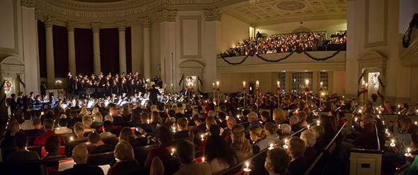"Audience members hold candles while they sing ""Silent Night"" at the end of the 2012 Holidays at Hendricks concert."