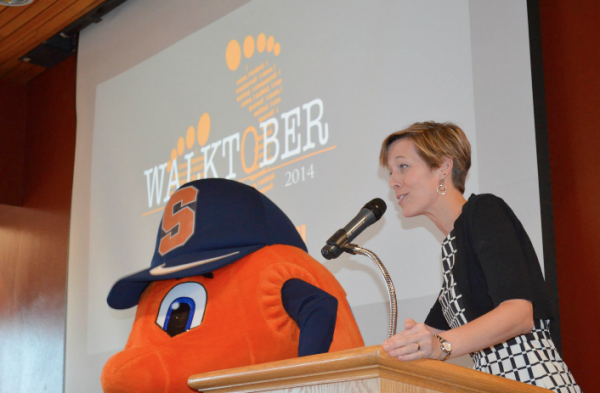 Lerner Center for Public Health Promotion Program Director, Rebecca Bostwick receives assistance from Otto in announcing the 2014 Walktober winners