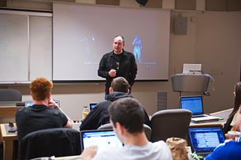 Professor Ulf Oesterle teaches a class in the Setnor School's multidisciplinary Bandier Program.
