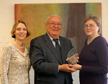 Alejandro Garcia receive the 2014 Advocate for Older Adults Award from Assistant Research Professor Maria Brown, right, as Sociology Professor Janet Wilmoth, director of the Syracuse University Aging Studies Institute, looks on.