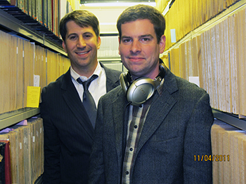 """Sound Beat"" writer Jim O'Connor, left, and narrator Brett Barry in the stacks at the Belfer Archive."