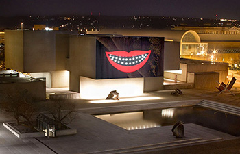 """Shuffle,"" the first part of Sanford Biggers' trilogy, is shown outside the Everson Museum."