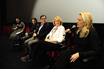 "Cheryl Strayed, right, answers a question during a Q&A after a screening of ""Wild"" in Los Angeles on Nov. 20. From left are Jenelle Riley, Nick Eversman, David Rubin and Nancy Haecker."