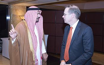 Syracuse University Chancellor Kent Syverud converses with Saudi Prince Faisal.