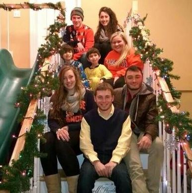 Julian's elves join him on the stairs after decorating his house for the holidays. Top row, from left: Tyler Patchet and Emily Gramlich; middle row, from left: Julian Ross, his brother Bray and Shannon Mowles of Mansfield; bottom row, from left: Hannah Berman, Eric Gallanty and Chris Torres
