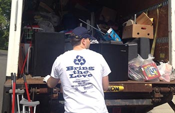 A volunteer collects items for a previous Ten Tons of Love drive.