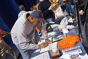 A customer bids on an item at the sports auction held at the Carrier Dome on Dec. 6.