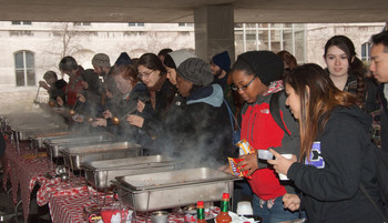 Hungry customers taste the chili at last year's chili cookoff.