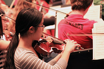A girl performs in the Syracuse Youth Orchestra.