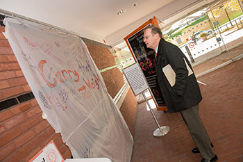 Chancellor Syverud reads the messages on a mattress cover presented by students last semester as part of Carry That Weight, a national day to support survivors of sexual and domestic violence on college campuses.