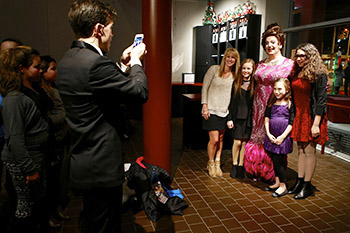 David Lowenstein (as Edna) poses with patrons in the lobby as Kyle Anderson (Corny Collins) takes a photo. Photo by Michael Davis.