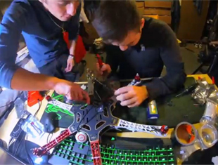 Members of the Skyworks Project assemble a drone.