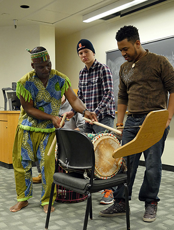 "Biboti Ouikahilo demonstrates African drumming for students in Carol Babiracki's ""Word Music"" course."
