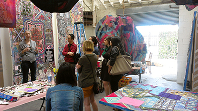 Artist Alexandra Grant, left, meets with VPA students in her LA studio.