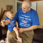 Eric Kingson and grandson Sammy show their support for Social Security.