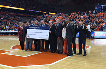 Representatives from First Data present the check for their $7 million donation to IVMF during the SU men's basketball game against Duke on Saturday.